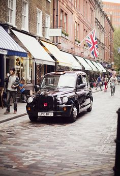Black cabs and the cobbled streets of Covent Garden