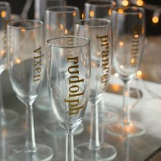 Gold Leaf Holiday Champagne Glasses | Why use wine charms when you can just pick a reindeer name?  Classy, fun, and super easy to make!