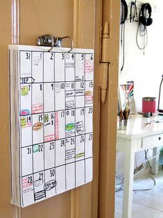 d.i.y. wall mounted family planner with corresponding chore chart.