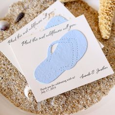 Send your guests home with an eco-friendly memento of your beach wedding day. These personalized plantable seed cards are handmade with a biodegradable paper embedded with wildflower seeds.  #EcoFriendlyBeachWeddingFavors #BeachWeddingThemedEcoFriendlyFavors #BeachWeddingPlantableFavors