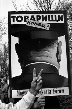 """© Abbas/Magnum Photos HUNGARY. Budapest. Poster says """" It's over comrades !"""". March 1990."""