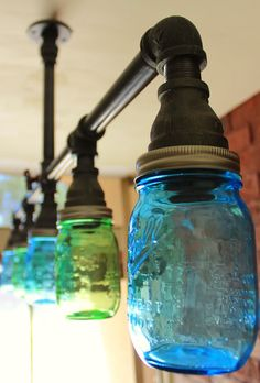 Industrial Farmhouse Mason Jar Chandler Light style ceiling light  Description: A Hanging Pendant Industrial light fixture - Crafted using black pipe accented with blue glass & Green OR Clear mason jars.  This industrial kitchen light / Chandelier will suit industrial & steampunk styled rooms, it will draw desirable attention and add an awesome focal point to your space! All fixtures in my shop are HANDMADE in house. We, my husband Dan and I, make high quality fixtures using high end…