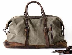 """Main Material: PremiumQuality canvas duffle accented with genuineleather. Size: L: 18"""" W:8"""" H:10"""" Interior: Two..."""