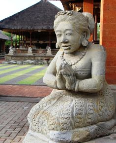 Balinese people often greet each other with their palms touching in prayer position. This statue welcomed me at the Pura Puseh Temple in Batuan.