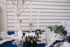 Www.clevents.ca #chantillylaceevents #cldesigns #winter #winterwedding #tablescape #navy #white #silver #greenery #branches #trees #vintage #vintageinspired #candles #tableswag #crystal