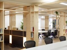 Offices of Kyoto-based web production company by Torafu architects. Offices for a variety of purposes, a spacious floor finely partitioned by wooden frames, allowing rooms of various sizes to flow into each other. The framework can also serve as shelves for work related stuff and for personal belongings.