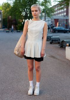 """""""I'm wearing second hand and Weekday shoes.At the moment I like to wear white, shiny materials and layers like skirt over trousers."""""""