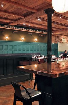 Blue panneling, copper bar top, and dark painted columns - general look for Propeller - La Hache Restaurant by Pascal Claude Drach // Strasbourg, France.