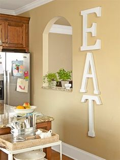 Room Makeover on a Budget Fill Space Creatively Anisa painted the $10 papier-mâché letters ( JoAnn.com ) on the kitchen wall (adsbygoogle = window.adsbygoogle || []).push({}); Source by designs10 http://centophobe.com/room-makeover-on-a-budget-2/