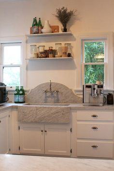 arched marble backsplash, could work in a bathroom too