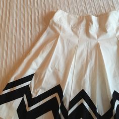 Black and white skirt  Gorgeous skirt with back chevron style design! NWT, never worn! Side zipper goes down about 5 inches on the left side. Zipper works perfectly. Pleating detail all over. Hits a little below the knee depending on your height. Has some minor fraying at the bottom but is hardly noticeable. **Size 6, but runs big! **Would fit an 8/10. Want this to go to a good home! I purchased this as a gift for my mom and it's too big for her  august silk Skirts A-Line or Full
