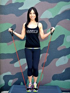 Take a tight resistance band, and stand on the middle of it with a slight bend in your knees. With your elbows close by your sides, slowly curl your arms up and down. Perform three sets of 15.