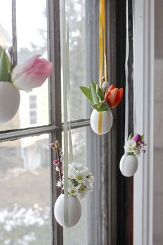 DIY Hanging Easter Eggs. Beautiful sunlight shines through your window in the Easter morning. Create this cool installation of light egg vase with flowers on your window.