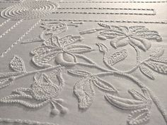 Mountmellick Table Cloth by Anne Fenlon.  Mountmellick Embroidery is created on White Satin Jean fabric using cotton thread and finishing with the traditional fringe.