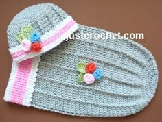 Free baby crochet pattern for cuddle pouch and hat http://www.justcrochet.com/cuddle-pouch-hat-usa.html #justcrochet