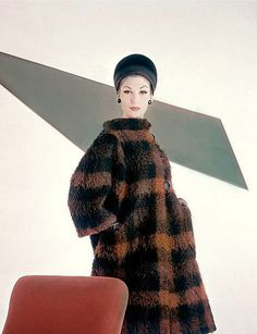 1962 Simone d'Aillencourt in fleecy wool, rust and black plaid coat by Marquise