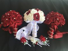 Stunning in its simplicity. Red and White roses with a bit of bling twirling around the handle.