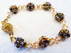 0975 - Crystal bracelet, seed bead bracelet, Swarovski crystals, rhinestone clasp, magnetic clasp, bead balls, seed beads, crystals by EarringsBraceletsEtc on Etsy