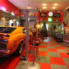 Angelika Ringuette designed a spectacular man cave for her husband Maurice in their two-storey, seven-car garage, which is decorated with race-deck flooring tiles and Coca-Cola memorabilia in St. Man Cave Basement, Man Cave Garage, Garage House, Dream Garage, Garage Shop, House Deck, Man Cave Diy, Man Cave Home Bar, Garage To Living Space