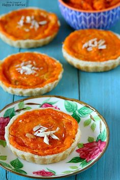 CARROT HALWA TARTS {WITH VANILLA-ORANGE CUSTARD}. Make the perfect dessert for Valentine's Day this year. From the flaky, buttery homemade tart crust to the decadent carrot halwa filling topped with a light and fresh vanilla-orange custard, this is one luscious treat! #happyandharried #carrot #gajar #halwa #pudding #tart #custard @vanilla #orange #eggless #dessert #valentines #recipe