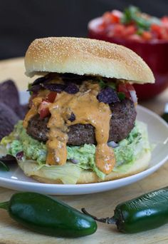 Nacho Burgers loaded with guacamole, fresh pico de gallo, spicy queso, and crushed blue tortilla chips.