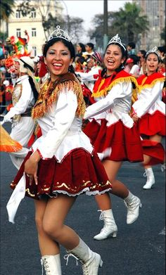 Occasion- Peruvian dancers perform in a street in Peru's capital of Lima, for a festival.