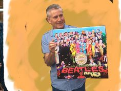 Jed C of Cardiff receives a print of the famous Beatles album cover Sgt. Pepper with superimposed images of his family and friends. The work was commissioned by his wife Liz as part of his 60th Birthday celebrations.