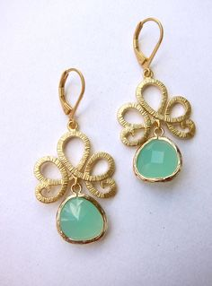Mint opal glass stone with swirly motif pendant earrings - matte gold plated. $27.00, via Etsy.