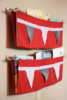 Hanging fabric shelf - I'd rather use it for toys. Books are too likely to get folded pages if the kid is stuffing them in that shelf. :(