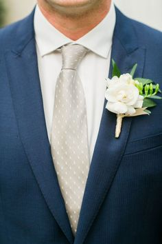 This navy blue groom's suit is such a dapper look! We love the dotted tie—a perfect mix of sophisticated, with a touch of personality. www.astylishsoiree.com