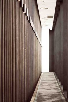 Vertical timber slats with integrated lighting at the Spa Corridor, Puli Hotel, in Shanghai Puli Hotel Shanghai, Architecture Details, Interior Architecture, Interior Design, Piscina Spa, Resort Interior, Hotel Corridor, Corridor Lighting, Public Hotel