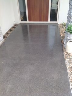 Ground and sealed front entrance. Quarter black concrete