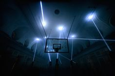 Hyperjump Kinetic Light Sculpture -  light installation by Russian collective Tundra and installed in study spaces in an old soviet basketball court, at the Saint-Petersburg State University.
