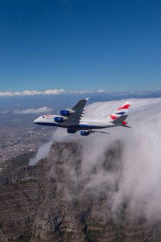 British Airways Airbus A380-841 G-XLED banking over Table Mountain, near Cape Town, during a promotional photo shoot on February 5, 2014. The aircraft had only been delivered the previous month. (Image: British Airways)