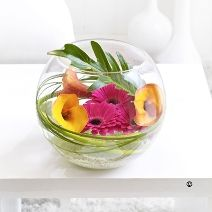 GLOBE ARRANGEMENT: Skillfully arranged in this stunning glass globe vase, calla lilies and gerberas entwine with foliages to create a sensual design. Other flo...