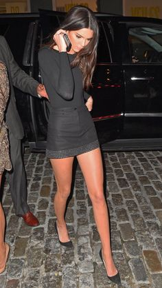 Kendall Jenner in a black mini dress.