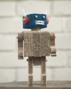 Oh he's so mad! Would love to have this little guy on my desk haha -- Clever recycled cardboard robots from Recurseos