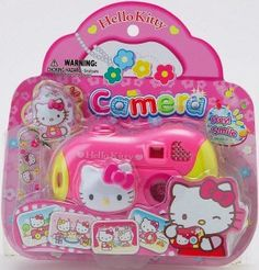 """Hello Kitty Toy Camera With Sounds & Light by sanrio. $13.71. Hello Kitty toy camera with light & sound...item #74492  Uses 3 """"LR44"""" size batteries (included)...H 7-1/2?x L 1-3/4?x W 7?"""