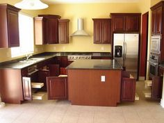 yellow kitchen walls with dark cabinets - Google Search
