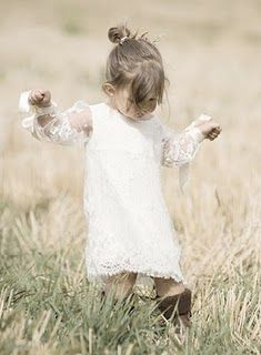 SO PRECIOUS I'M DYING! I ADORE the lace overlay and the sheer lace sleeves! Pair with cowboy boots and her messy little bun and its perfect for an outdoor wedding! Give her some simple cute sandals and curl her hair and add a hair band or flower halo and it would work for a more fancy ceremony!-ss