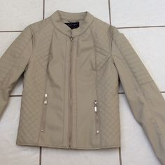 SALE!! NWT Faux leather Moto Beige Jacket  Fully lined, zippered front pockets. Shell 100% polyurethane with rayon backing, lining 100% polyester. Jackets & Coats