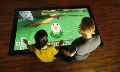 """Gather round! Playing Minecraft on a Colossus gives gameplay a big boost. The Ultra HD resolution offers unmatched clarity, and the 84"""" display makes for a very immersive gaming experience.   Prequel video for Minecraft on one of our coffee tables can be found  here. Visit our website to find more about our multitouch tables and touch walls."""