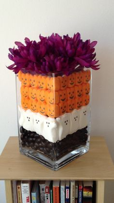 Halloween Centerpiece with different flowers and dome candles maybe a mirror plate?