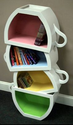 LOVE this bookcase. Made by design engineer Scott Blackwell, the whimsical bookcase — which is reminiscent of Alice In Wonderland — has been constructed out of hardwood ply, and gives the allusion of teacups gently falling into one another. Creative Bookshelves, Bookshelf Design, Bookshelf Ideas, Shelving Ideas, Bedroom Bookshelf, Kitchen Bookshelf, Bookshelf Plans, Kitchen Nook, Kitchen Storage