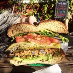 Whole wheat bun, homemade spicy black bean patty, sprouts, tomato, lettuce, Ortega chiles, jalapeños and avocado from Cafe, Cambria, California