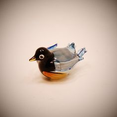 Glass Animal Figurine: a Fairy Penguin treasure.  Little glass art blue penguin statuette in boro glass.. $12.00, via Etsy.