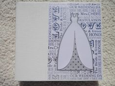 This 6x6 inch chipboard scrapbook album would be wonderful for a wedding or bridal shower. This album has 14 pages and includes mats for 15