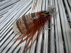 Fly fishing Wedding boutonniere Etsy -Fishfinsflys $9.00 each Rustic, outdoors, red, brown, black, white, custom, hook, lure, fishing, nautical, decor, ocean, beach, boutonnieres, weddings, mens wedding decor, fashion, brooch, pins, pin