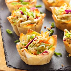 These Thai Peanut Salad Wonton Cups feature a delicious Thai-inspired peanut dressing over shredded veggies, topped with crushed peanuts!