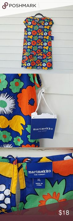 """NWT Marimekko For Target Girls Shift Dress Marimekko For Target Girls Primary Kukkatori Print. Marimekko for Target Girls' Cap Sleeve Dress in the Kukkatori Print with the Primary color theme. This girls' short-sleeve dress has a V-neck, cap sleeves, a super- patch pocket, a sweet loop-and-button closure in the back and a hemline that hits at mid-thigh. Kukkatori, or """"flower market"""" in Finnish, was inspired by the abundance of colorful flowers at a marketplace in the summer. Size XL 14/16…"""